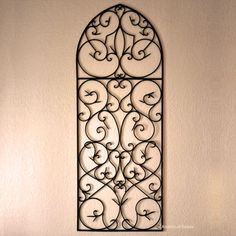 wrought iron wall hanging...would like this better in front of a brightly colored wall