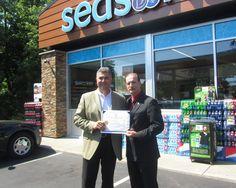 Seasons Corner Market CEO Andrew Delli Carpini opening a new Seasons Corner Market with Rhode Island State Representative Robert D. Phillips