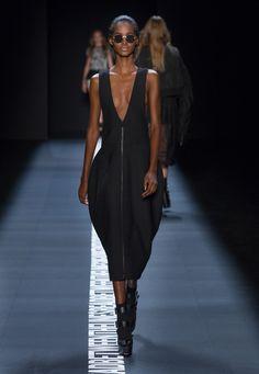 LOOK 28. Black wool V-neck zip front bell dress.