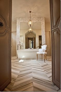 Grand Mirror And Beautiful Tub Chandelier