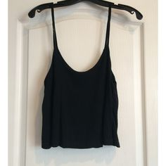 Brandy Melville Black Tank Top In really good condition, no rips or snags. Scoop neck. If you have any questions feel free to ask!! Thanks for looking!! Brandy Melville Tops Tank Tops