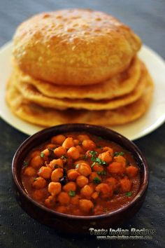 Chole Bhature http://www.tasty-indian-recipes.com/snacks-recipes/chole-bhature-recipe/