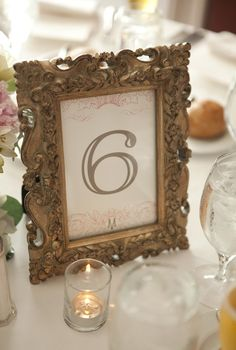 Frames are cute....elegant yet a little rustic. spray paint in coral? or white with coral scrapbook paper?