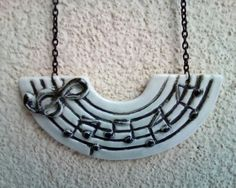 Check out this item in my Etsy shop https://www.etsy.com/listing/174886365/porcelain-music-necklace-on-a-black