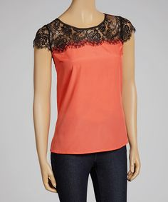 For a flirty finish, don this simple, chic blouse. Featuring an ethereal sheer lace neckline and a casual fit, this posh piece ensures comfort is synonymous with style.