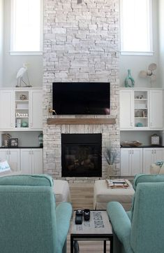 Check out our Home of the Month feature: A Serene Ocean Isle Beach Home – Dream House – Coastal Decor – Simple Stylings – www.simplestyling… – North Carolina – Beach House – Stone Fireplace – wood look tile floors – custom built-ins Beach Fireplace, Home Fireplace, Fireplace Remodel, Living Room With Fireplace, Fireplace Design, Fireplace Ideas, Fireplace Stone, Stacked Stone Fireplaces, Beach Style Fireplaces