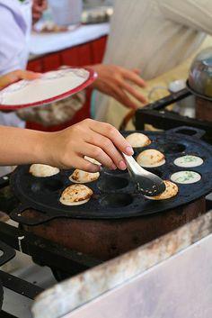 kanom krok - world's most heavenly snack.  recipe here: http://www.templeofthai.com/recipes/kanom_krok.php    how to season my new cast iron kanom krok pan: http://www.templeofthai.com/cooking/cast_iron_cookware.php