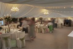 Marquee venues are fabulous in spring or summer and adding a touch of green will make your wedding celebration look simply stunning.