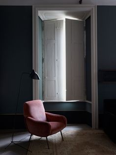 """scandinaviancollectors: """"Interior design by Dimore Studio, photograph by Henry Bourne: Serge Mouille tripod floor light ca.1950s and Marco Zanuso´s Lady armchair by Artflex, 1951. / Yellow Trace """""""