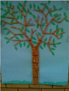 use stick pretzels to make the tree.....this person cut out leaves but I think using green finger paint and thumb prints would be cuter!