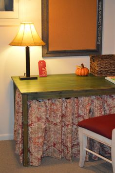 use tension rods and curtains to hide under table storage boxes