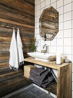 great design for bathroom with a mox of rough wood walls, white tile and wood vanity