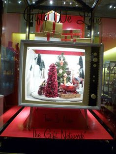 A window display with rotating diorama set in vintage television set