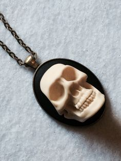 3D Skull Cameo Necklace Pendant in Brass Gothic  by ToxicRomanceJewelry on Etsy https://www.etsy.com/listing/232847826/3d-skull-cameo-necklace-pendant-in-brass