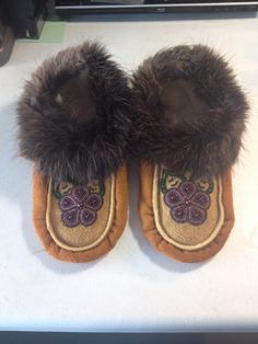 Women's handmade slippers with Beaver trim. Made by Alaska Beadwork