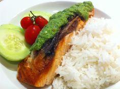 Salmon with pesto sauce on rice