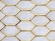 Handmade hexagon ceramic tiles in white with yellow borders