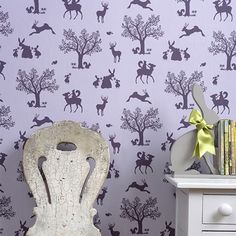 Enchanted Wood Wallpaper A delightful children's wallpaper depicting a fantasy woodland scene in silhouettes of aubergine on lilac.