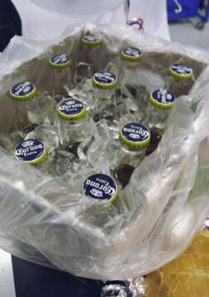 Turn a case of beer into a toss-away drink cooler. | 41 Tailgating Tips That Are Borderline Genius