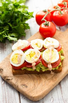 Healthy Avocado, Tomato, and Egg Toast. This open-faced sandwich is perfect for breakfast or lunch. | www.themessybakerblog.com