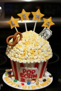 Hidden beneath the disguise of a popcorn bucket is a giant red velvet flavored c. Big Cupcake, Giant Cupcake Cakes, Fondant Cakes, Mini Cakes, Home Made Cupcakes, Red Velvet Flavor, Popular Cheeses, Popcorn Cake, Novelty Birthday Cakes