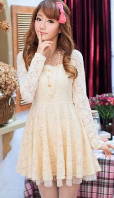 Yugana dress   Very pretty delicate floral lace short dress in cream, A long sleeved dress which is fully lined with a heart net hem. Square collar lined with a crochet trim. Elasticated around the waist. Four pearl buttons with crown emblem charms finish the look.