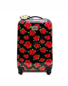 Mine: betsey johnson rolling carry on luggage