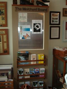 Old door with window and church pew hymn holder made into a bulletin board/brochure holder.