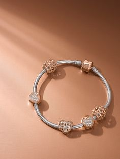 The feminine blush-colored metal lends lustrous sheen and vintage appeal to bestselling classics and exciting new designs, highlighting the beauty of sparkling stones. #PANDORA #PANDORArose #PANDORAbracelet