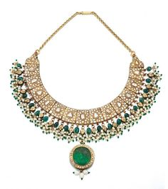 GEM SET, ENAMEL AND DIAMOND PENDANT NECKLACE, RAJASTHAN | Designed as a series of links set with flat-cut diamonds, suspending a fringe of seed pearls and polished emerald beads, some inset with diamonds, the detachable pendant at the front set with a carved paste stone encircled with diamonds, the reverse of the necklace decorated with bird, floral and foliate motifs decorated with safed chalwan enamel, length approximately 380mm.