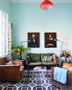 robin's egg blue walls, green sofa