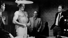 Mitchum is so obviously sucking in his gut in this scene, he might as well be wearing an invisible corset.