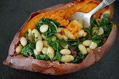 healthconsciousness:  mayurasana:   Stuffed Sweet Potatoes with Beans and Greens  What could be better than this?  This is what I'm making for dinner tonight!! :) But with russet potatoes.