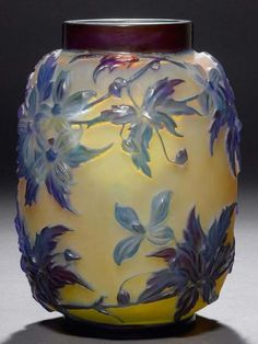 EMILE GALLE VASE SOUFFLE, circa 1920 Yellow glass with blue overlay and etching. Cylindrical vase, decorated with clematises. Art Nouveau, Glass Ceramic, Ceramic Art, Jugendstil Design, Art Deco Glass, Stained Glass Art, French Art, Antique Glass, Ceramic Sculptures