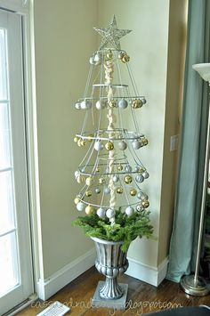 Old lampshades made into a Christmas Tree. Could also be a fun seasonal tree especially if it was wrapped with fabric