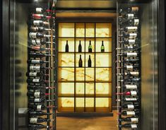 Backlit Onyx stone in a wine cellar Bar Table Design, Bar Counter Design, Wall Art Uk, Built In Wine Rack, Wine Cellar Design, Stone Bar, Wine Display, Glass Room, Wine Glass Rack