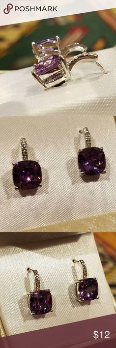 Gorgeous NEW Amethyst and Rhinestone Earrings New in box, Purple (amethyst glass) and rhinestone in silver tone pierced earrings. Comes in original box marked $20  box has 2 spots on top like water stains as seen in the photos.  Very pretty ~ unbranded Jewelry Earrings
