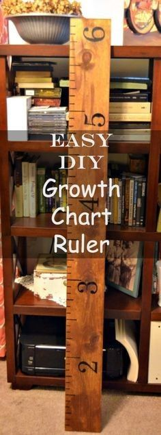 how-to-make-growth-chart-ruler- this was really easy to make and I actually used my cricut to make the templates for the numbers. First we stained the wood to the color we wanted then I wrote the numbers and markings on with a sharpie after that dried then we did 3 coats of polyurethane. I used a 6 foot board and started my markings at 1 foot and went to 7 feet (in hopes that my kids will be tall).