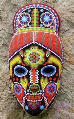 Higinio Hernandez Carrillo: Beaded mask, 'Green Jicuri Flower' Symmetry, Colour, and design suitable for deck. Mexican Mask, Mexican Folk Art, Mexican Cakes, Masks Art, Clay Masks, Huichol Art, South American Art, African Masks, Indigenous Art