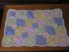 "19"" X 28"" baby blanket. Granny squares decorated with flowers. Too Cute"