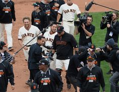 The San Francisco Giants' Gregor Blanco (7) and Hunter Pence (8) celebrate their victory over the St. Louis Cardinals in Game 3 of the National League baseball championship series at AT&T Park in San Francisco, Calif., on Tuesday, Oct. 14, 2014. (Dan Honda/Bay Area News Group)