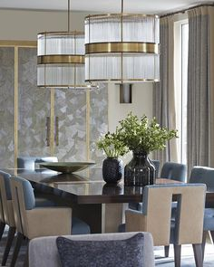 The dining room of one of our Knightsbridge Penthouses. The glass and brass pendant lights over the table lend a sophisticated glamour to the space #diningroom #pendantlights #luxuryinteriors #helengreendesign #knightsbridge #penthousenorth #hgdflowers #liveableluxury