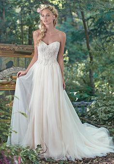 A-line gown with sweetheart neckline, beaded bodice, tulle skirt, and embellished lace I Style: Sabina I by Maggie Sottero I https://www.theknot.com/fashion/sabina-maggie-sottero-wedding-dress?utm_source=pinterest.com&utm_medium=social&utm_content=sep2016&utm_campaign=beauty-fashion&utm_simplereach=?sr_share=pinterest