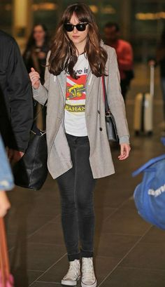 Dakota Johnson has been shooting for the eagerly awaited second installment of the BDSM romance titled as Fifty Shades Darker and the strains of the work clearly showed as she looked on the weary side while arriving at the Vancouver International Airport ahead of a flight on April 9, 2016. Despite being tired, she didn't compromise on her style as she looked gorgeous in a casual chic ensemble for her trip back home.