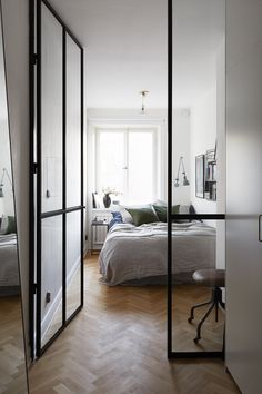 Bedroom behind a glass partition - via Coco Lapine Design