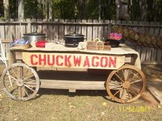 took an old wooden table . add wheels and a sign.Our Chuck Wagon. Cowboy Party, Cowboy Theme, Western Theme, Western Decor, Hoe Down Party, Country Western Parties, Wild West Party, Barn Dance, Cowboy Christmas