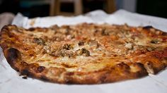 White clam pie ingredients: (1) 36 littleneck clams (2) 1/2 cup grated Pecorino Romano (3) 1 tablespoon dried oregano (4) 1 teaspoon freshly ground black pepper (5) 2 cloves garlic, minced (6) 1/4 cup extra-virgin olive oil (7) Naples-style pizza dough