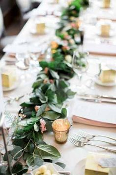 foliage garland running along table with gold tea light hlders to add a touch of glamour