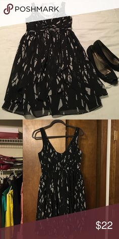 Max & Cleo black and silver dress Max and Cleo black and silver dress. Gorgeous dress with flowy material. Excellent condition, like new. Brand runs small overall, the size is 8 but feels more like a size 6. True to Max and Cleo BCBG size chart http://www.bcbg.com/en/cs-size-chart.html Max & Cleo Dresses Mini