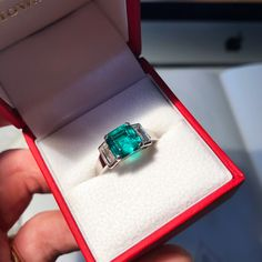Emerald and diamond engagement ring by LMH. The central stone was repolished and given a new lease of life by my lapidary. Flanked by baguette diamonds and set in platinum.